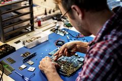 Technician is working on computer mainboard Stock Photos