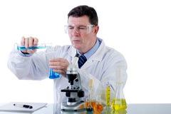 Technician working at laboratory. Technician with microscope working at laboratory Stock Images