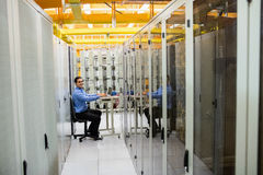Technician working on laptop. In server room Stock Image