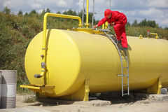Technician  working on large fuel tank Stock Photo