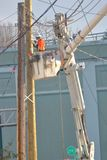 Technician Working on New Power Pole royalty free stock images