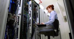 Technician working beside open server stock footage