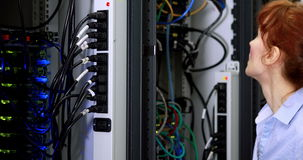 Technician working beside open server stock video footage
