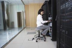 Technician Working In Server Room Stock Photos