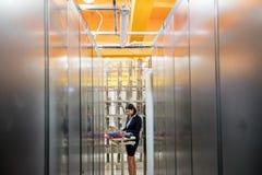 Technician working in server room Stock Image