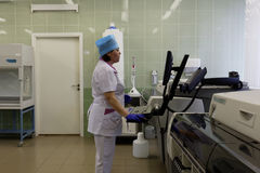 Technician works with analyzer in the blood bank Stock Photo