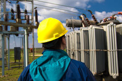 Technician with yellow helmet inspect high voltage power station royalty free stock photography