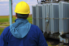 Technician with yellow helmet inspect high voltage power station royalty free stock image