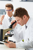 Technicians Carrying Out Research In Laboratory Stock Photography