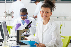 Technicians Carrying Out Research In Laboratory Stock Photos