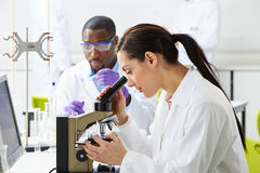 Technicians Carrying Out Research In Laboratory Stock Photo