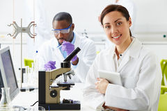 Technicians Carrying Out Research In Laboratory Royalty Free Stock Photos