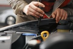 Technicians are checking car engines. Close up Royalty Free Stock Photo
