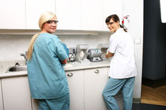 Technicians in dental lab. Two dental technicians in dental lab Royalty Free Stock Photo