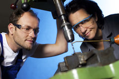 Technicians drilling in workshop Stock Photos