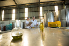 Technicians examining olive oil. In factory Stock Images
