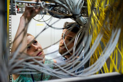 Technicians fixing cable Stock Images