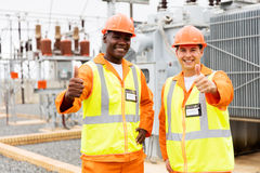 Technicians giving thumbs up Stock Images