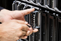 IT Technicians Hands Working On Server At Data Center Royalty Free Stock Photo