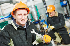 Technicians of heating system in boiler room Royalty Free Stock Image