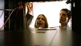 Technicians looking at open server locker stock footage