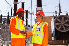 Technicians meeting substation Stock Photos