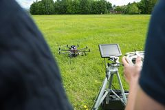 Technicians Operating UAV Helicopter in Park Stock Photos