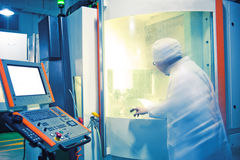 Technicians in the operation of CNC machine tool p Royalty Free Stock Images