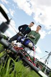 Technicians With Remote Controls Of UAV. Low angle view of young technicians standing with remote controls of UAV in park royalty free stock photos