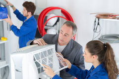 Technicians repairing industrial air conditioning compressor Royalty Free Stock Photos