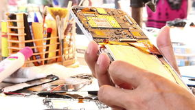 Technicians are repairing  mobile phone. stock footage