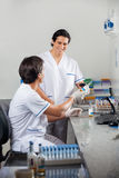 Technicians Scanning Barcode On Specimen Stock Image