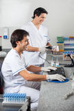 Technicians Scanning Sample With Barcode Reader royalty free stock image