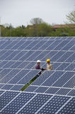 Technicians at Solar Power Station Royalty Free Stock Photo
