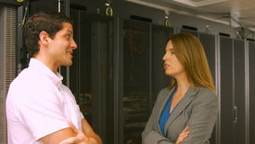 Technicians talking in the server room. In high quality format stock footage