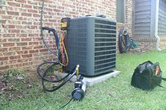 Home air conditioner maintenance and repair royalty free stock images