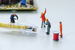 Technicians try to repair cable wire network. Miniature people Stock Photos
