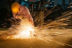 Technicians use steel cutting tools to build houses. Royalty Free Stock Photography