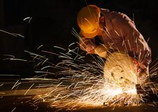 Technicians use steel cutting tools to build houses. Stock Images
