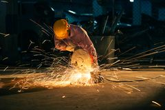 Technicians use steel cutting tools to build houses. Stock Image
