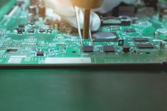 Technicians are using hot air blowing to part on electronic board. Royalty Free Stock Images