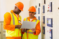 Technicians using laptop. Successful technicians using laptop in control room Stock Images