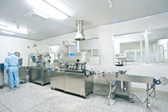 Technicians work in the production line. Technicians working in the pharmaceutical production line Stock Images
