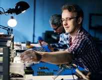 Technicians working on electronics parts royalty free stock images