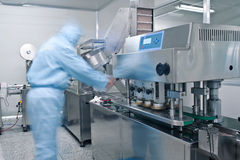 Technicians working in the pharmaceutical production Royalty Free Stock Images
