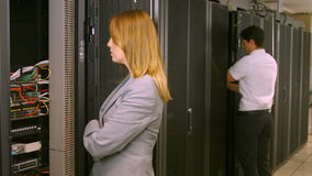 Technicians working in the server room stock footage
