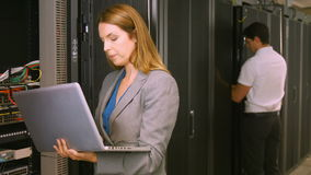 Technicians working in the server room stock video footage