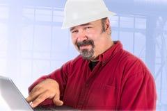 Technicien Smiling Trustfully de masque Photos stock