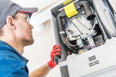 Technicus en Heater Issue royalty-vrije stock fotografie