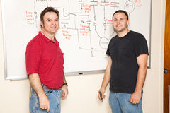Technik-Kursteilnehmer und Lehrer Stockbild